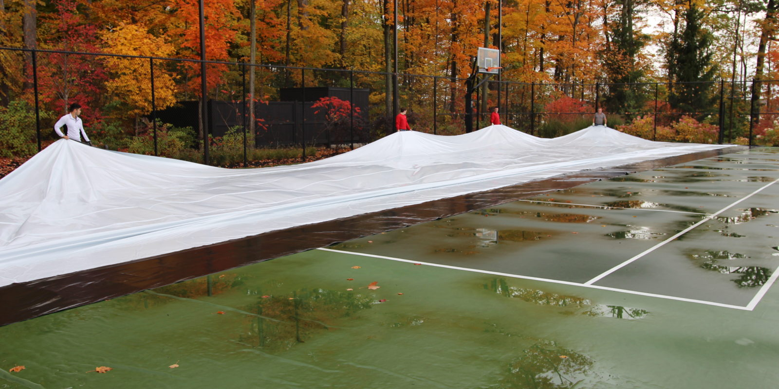 Portable refrigerated ice rink on tennis court